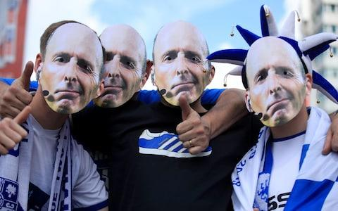 Tranmere Rovers wearing masks of referee Mike Dean outside the ground before the Sky Bet League Two Play-off final at Wembley Stadium, London - Credit: PA