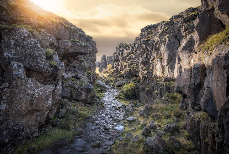 """Thingvellir is one of Iceland's two UNESCO sites and one of the most consistently popular tourist destinations in the country. You could spend hours hiking and horseback riding through the national park on your own, but we suggest booking a snorkeling or diving excursion to swim the <a href=""""https://www.cntraveler.com/galleries/2016-07-13/11-hauntingly-beautiful-underwater-sites?mbid=synd_yahoo_rss"""" rel=""""nofollow noopener"""" target=""""_blank"""" data-ylk=""""slk:Silfra fissure"""" class=""""link rapid-noclick-resp"""">Silfra fissure</a>—a slowly widening rift between the Eurasian and North American tectonic plates."""