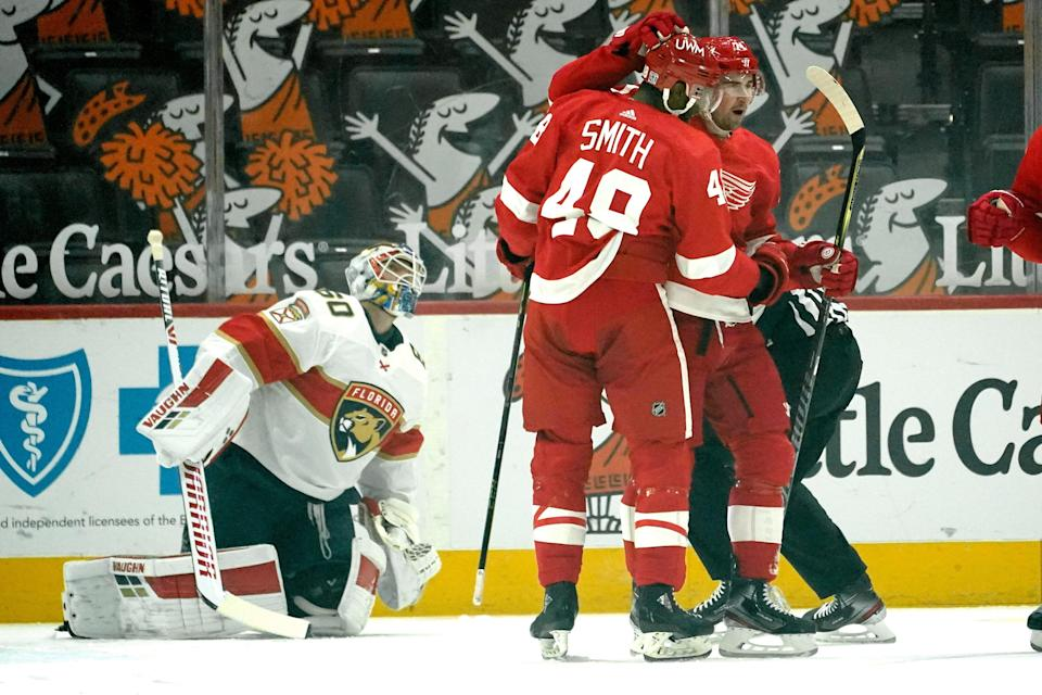 Red Wings center Dylan Larkin celebrates his goal with Givani Smith as Panthers goaltender Chris Driedger looks on in the first period on Sunday, Jan. 31, 2021, at Little Caesars Arena.