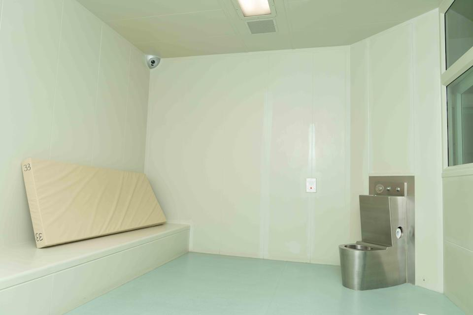 """The tweet included a photo of a cell, which described the decor as """"minimalist"""". Source: Twitter/ACT Policing"""