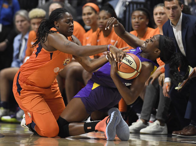 Connecticut Sun's Shekinna Stricklen, left, pressures Los Angeles Sparks' Chiney Ogwumike, right, during the second half of Game 1 of a WNBA basketball playoff game, Tuesday, Sept. 17, 2019, in Uncasville, Conn. (AP Photo/Jessica Hill)