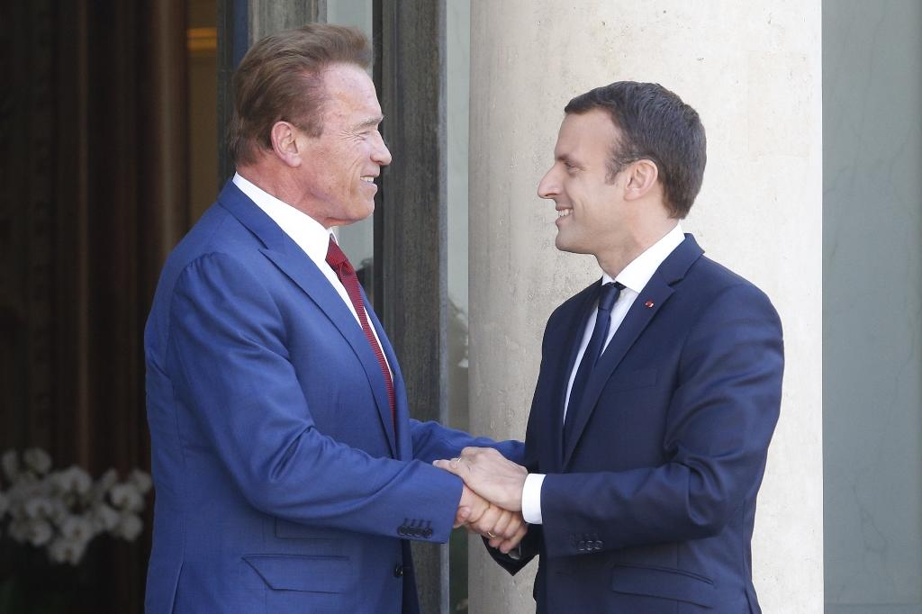 "Former California governor Arnold Schwarzenegger urged people on all ends of the political spectrum to join an ""environmental crusade,"" the actor said after a Friday meeting with French President Emmanuel Macron (AFP Photo/GEOFFROY VAN DER HASSELT)"