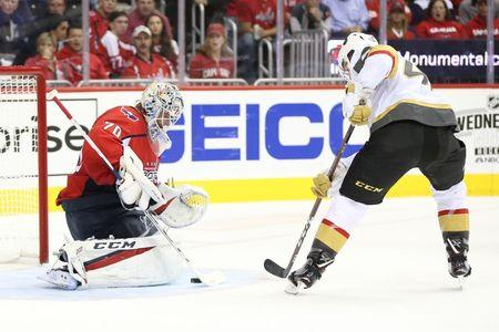 Oct 10, 2018; Washington, DC, USA; Washington Capitals goaltender Braden Holtby (70) makes a save on Vegas Golden Knights center Ryan Carpenter (40) in the second period at Capital One Arena. Mandatory Credit: Geoff Burke-USA TODAY Sports