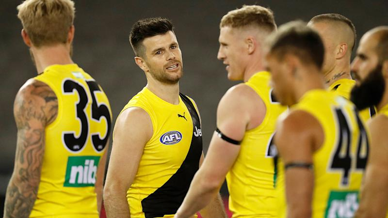 Pictured here, Richmond captain Trent Cotchin with his teamates.
