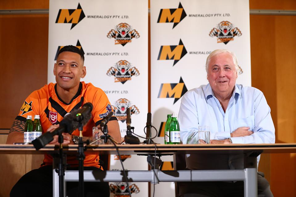 Israel Folau (pictured left) and Clive Palmer (pictured right) speak to the media during a press conference at the Hilton Hotel on May 21, 2021 in Brisbane, Australia.