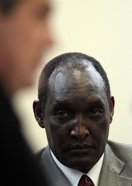 Rwandan former Gen. Faustin Kayumba Nyamwasa, looks on as a lawyer Gerhard van der Merwe, representing the Rwandan government interrupts the proceedings in a court in Johannesburg, South Africa, Wednesday, June 20, 2012. Nyamwasa, a critic of his former boss Rwandan President Paul Kagame, took the stand as a witness Wednesday, making his first public appearance since he was shot and wounded in Johannesburg in 2010. (AP Photo/Themba Hadebe)
