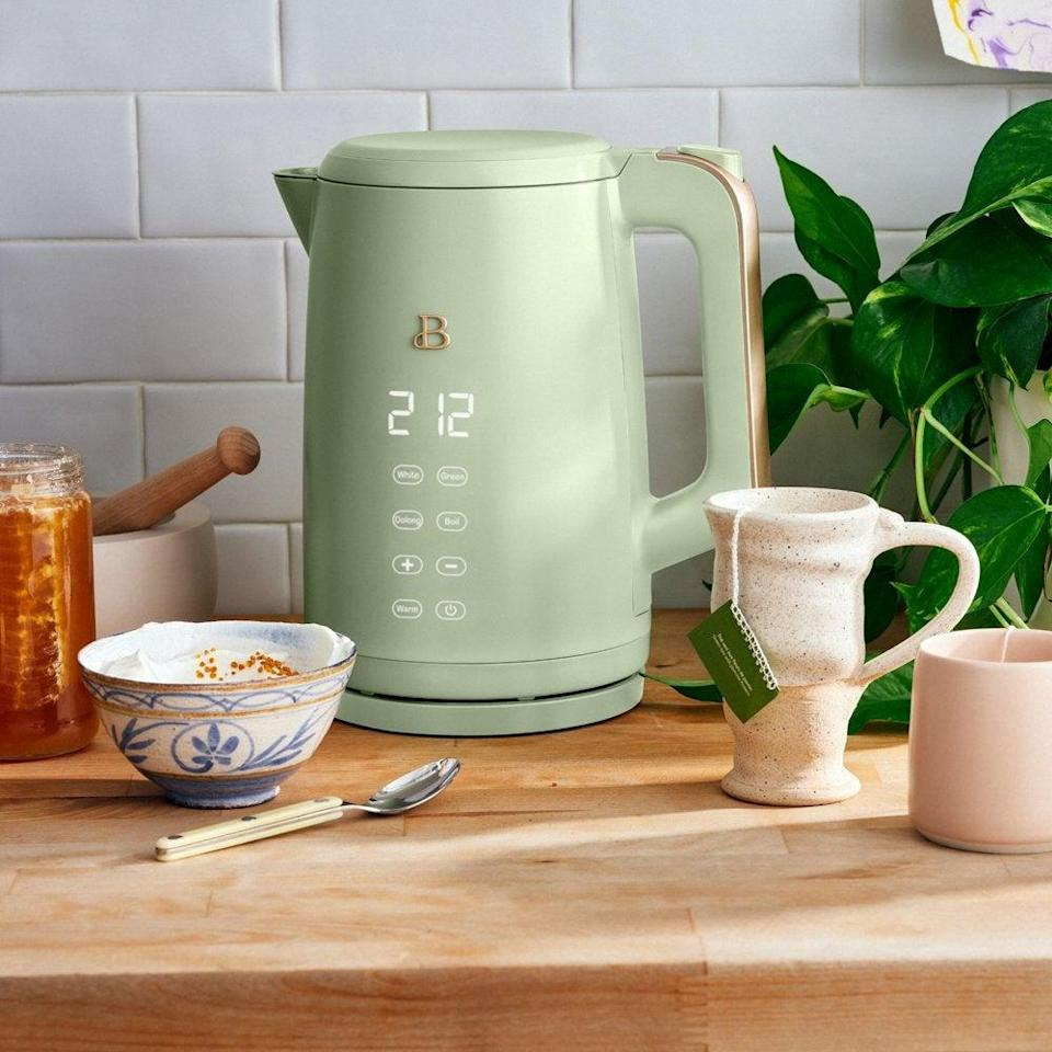 """<h2>Beautiful By Drew Barrymore One-Touch Electric Kettle</h2><br>Drew Barrymore debuted a collection of pistachio-green kitchenware at Walmart In collaboration with <a href=""""https://madebygather.com/"""" rel=""""nofollow noopener"""" target=""""_blank"""" data-ylk=""""slk:Made by Gather"""" class=""""link rapid-noclick-resp"""">Made by Gather</a> founder Shae Hong — and shoppers (including myself) went IN on this affordable-chic electric kettle. In place of buttons or knobs, Barrymore designed the new line to look good just sitting out in plain sight on your counter. Each boasts a signature touch-activated display that only lights up when touched. Beautiful.<br><br><em>Shop <strong><a href=""""https://www.walmart.com/ip/Beautiful-1-7L-One-Touch-Electric-Kettle-Sage-Green-by-Drew-Barrymore/587407613"""" rel=""""nofollow noopener"""" target=""""_blank"""" data-ylk=""""slk:Walmart"""" class=""""link rapid-noclick-resp"""">Walmart</a></strong></em><br><br><strong>Beautiful</strong> 1.7L One-Touch Electric Kettle, $, available at <a href=""""https://go.skimresources.com/?id=30283X879131&url=https%3A%2F%2Fwww.walmart.com%2Fip%2FBeautiful-1-7L-One-Touch-Electric-Kettle-Sage-Green-by-Drew-Barrymore%2F587407613"""" rel=""""nofollow noopener"""" target=""""_blank"""" data-ylk=""""slk:Walmart"""" class=""""link rapid-noclick-resp"""">Walmart</a>"""