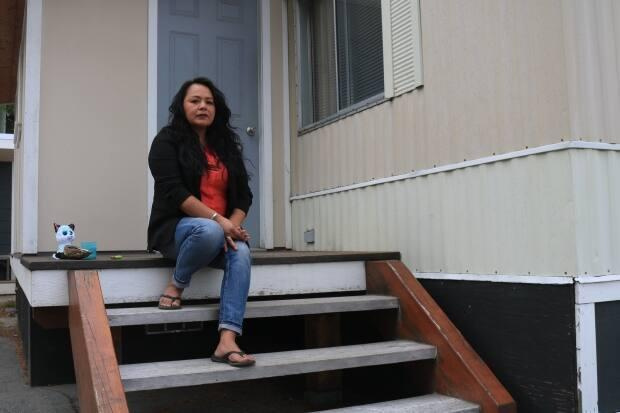 Tara Aleck was sitting on her front steps holding a personal vigil for the victims of the Kamloops residential school when she says two men hurled racial insults at her. (Jon Hernandez/CBC - image credit)