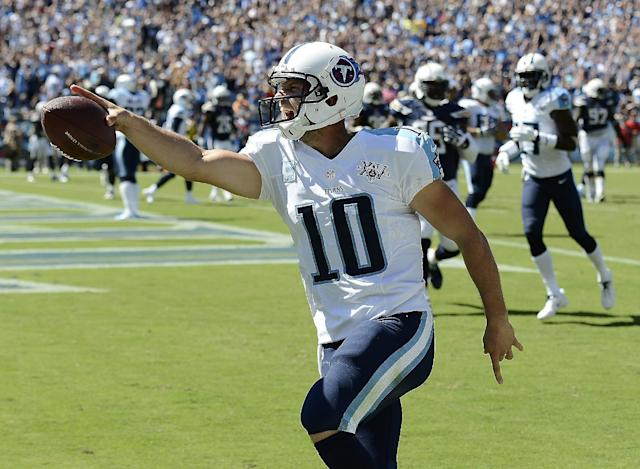 Tennessee Titans quarterback Jake Locker (10) celebrates as he scores a touchdown on a 7-yard run against the San Diego Chargers in the second quarter of an NFL football game on Sunday, Sept. 22, 2013, in Nashville, Tenn. (AP Photo/Mark Zaleski)