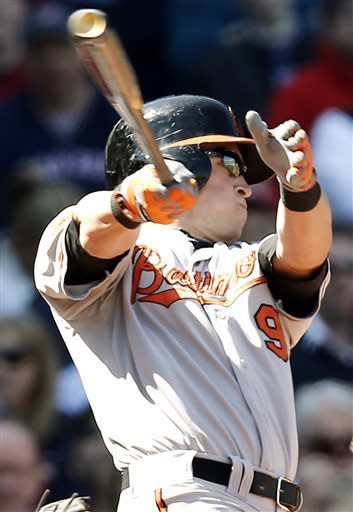 Baltimore Orioles' Nate McLouth follows through on a single during the first inning of a baseball game against the Boston Red Sox at Fenway Park in Boston Monday, April 8, 2013. (AP Photo/Winslow Townson)