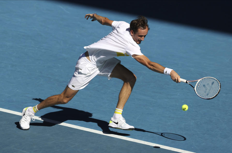 Russia's Daniil Medvedev hits a backhand return to compatriot Andrey Rublev during their quarterfinal match at the Australian Open tennis championship in Melbourne, Australia, Wednesday, Feb. 17, 2021.(AP Photo/Hamish Blair)