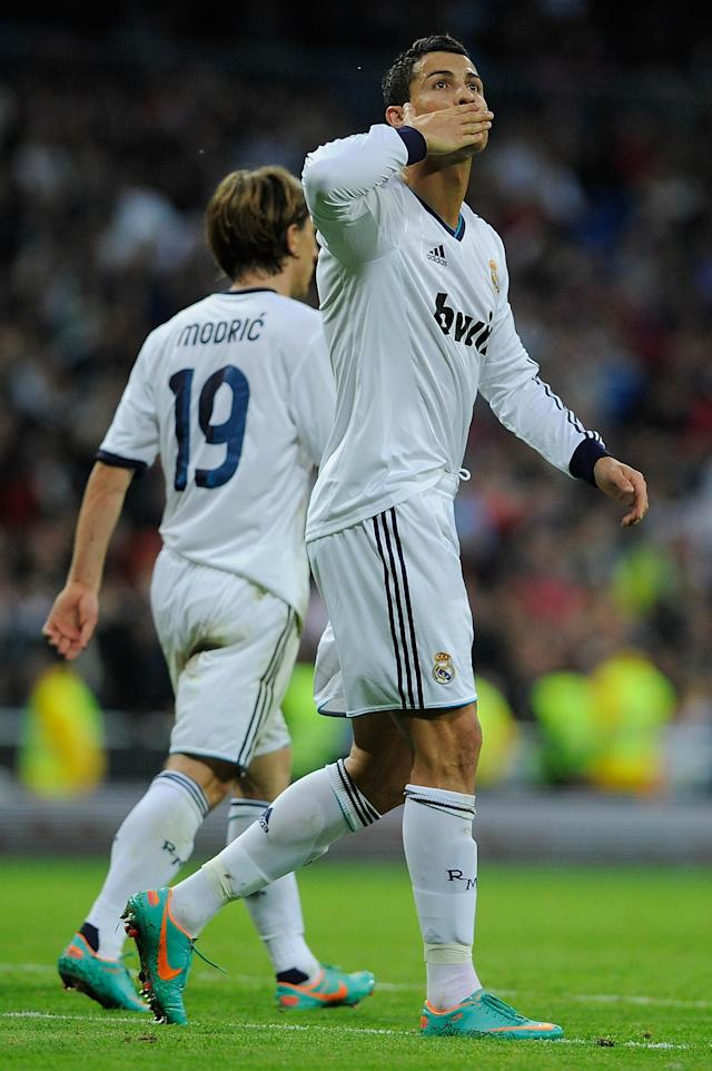 MADRID, SPAIN - OCTOBER 20: Cristiano Ronaldo of Real Madrid CF celebrates scoring their second goal during the La Liga match between Real Madrid CF and RC Deportivo La Coruna at Bernabeu on October 20, 2012 in Madrid, Spain. (Photo by Gonzalo Arroyo Moreno/Getty Images)