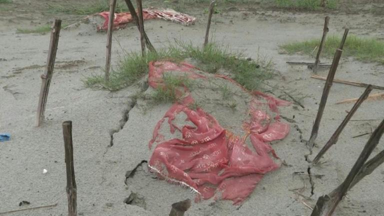India's Covid graves exposed as Ganges river floods