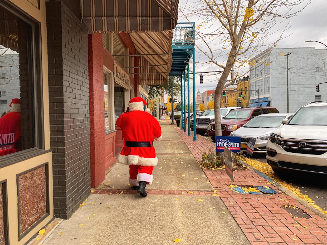A man who identified himself as Santa leaves a campaign rally for Sen. Cindy Hyde-Smith in Columbus, Miss. (Photo: Holly Bailey/Yahoo News)