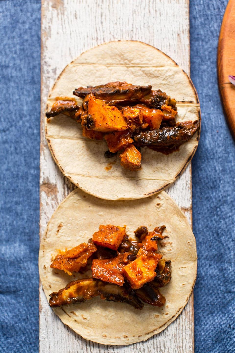 """<p>Mushrooms are sort of the OG meat substitute, thanks to their hearty, juicy texture when cooked. Slather them in smokey adobo sauce, and you've got yourself a taco masterpiece.</p> <p>Get the recipe <a href=""""https://minimalistbaker.com/saucy-portobello-butternut-squash-tacos/"""" rel=""""nofollow noopener"""" target=""""_blank"""" data-ylk=""""slk:here"""" class=""""link rapid-noclick-resp"""">here</a>.</p>"""