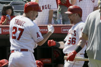 Los Angeles Angels' Kole Calhoun, right, congratulates Mike Trout for Trout's solo home run during the sixth inning of the team's baseball game against the Detroit Tigers in Anaheim, Calif., Wednesday, July 31, 2019. (AP Photo/Alex Gallardo)
