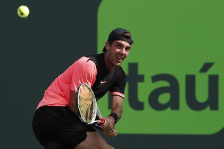 Mar 24, 2018; Key Biscayne, FL, USA; Thanasi Kokkinakis of Australia reaches for a backhand against Roger Federer of Switzerland (not pictured) on day five of the Miami Open at Tennis Center at Crandon Park. Kokkinakis won 3-6, 6-3, 7-6(4). Mandatory Credit: Geoff Burke-USA TODAY Sports