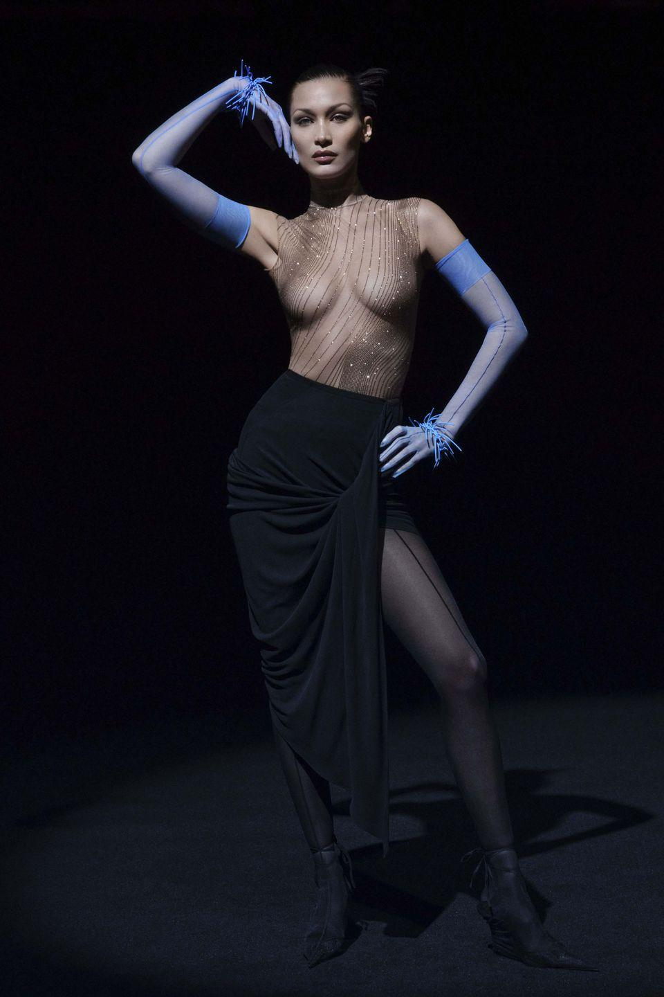 "<p>Mugler presented the second part of its spring/summer 2021 collection last night, having revealed the first during the show schedule back in October. This new approach is part of a new strategy for the house which allows retail partners to purchase and<br>sell the collection in two parts. Presented via a six-minute film that featured the likes of Bella Hadid, Irina Shayk, Alek Wek and Hunter Schafer, the collection was a ""no-holds-barred expression of electric Mugler energy,"" the house explained in its show notes. Scroll through to see highlights from the collection, or <a href=""https://www.youtube.com/watch?v=2glLbCTR22E"" rel=""nofollow noopener"" target=""_blank"" data-ylk=""slk:watch the show in its entirety here"" class=""link rapid-noclick-resp"">watch the show in its entirety here</a>. </p>"