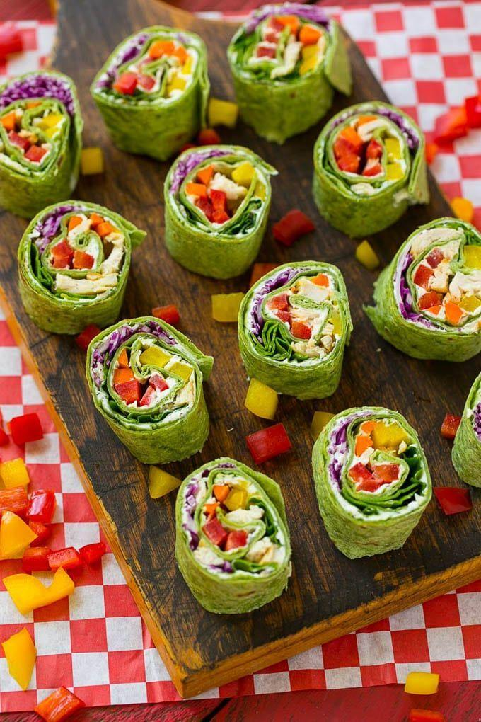"<p>These ranch-flavored roll-ups will fly off the platter.</p><p><strong>Get the recipe at <a href=""https://www.dinneratthezoo.com/rainbow-veggie-pinwheels-sesame-lime-quinoa-salad/"" rel=""nofollow noopener"" target=""_blank"" data-ylk=""slk:Dinner at the Zoo"" class=""link rapid-noclick-resp"">Dinner at the Zoo</a>.</strong></p>"