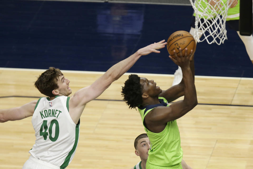 Minnesota Timberwolves forward Anthony Edwards (1) shoots in front of Boston Celtics center Luke Kornet (40) in the first quarter during an NBA basketball game, Saturday, May 15, 2021, in Minneapolis. (AP Photo/Andy Clayton-King)