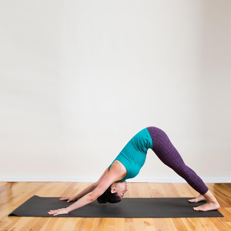 <ul> <li>From Standing Forward Bend Clasped Elbows, place the hands at the front of the mat and walk the feet back, coming into the classic upside-down-V shape called Downward Facing Dog.</li> <li>Focus on straightening the legs and pressing the heels toward the floor to increase the stretch in the backs of the legs.</li> <li>Stay in Down Dog for five deep breaths.</li> </ul>