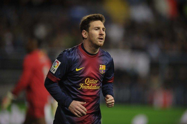 Lionel Messi looks on during the Spanish Copa del Rey quarter-final match against Malaga in Malaga on January 24, 2013