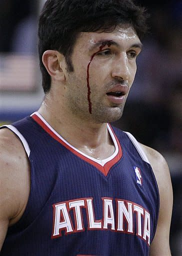 Atlanta Hawks' Zaza Pachulia returns to the bench after sustaining a cut during the first half of an NBA basketball game against the Golden State Warriors Wednesday, Nov. 14, 2012, in Oakland, Calif. (AP Photo/Ben Margot)