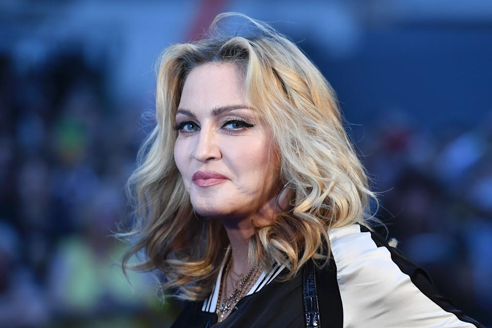 "Madonna poses arriving on the carpet to attend a special screening of the film ""The Beatles Eight Days A Week: The Touring Years"" in London on September 15, 2016. (AFP / Ben STANSALL via Getty Images)"