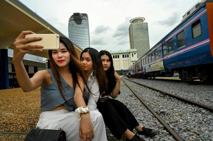 Train travel has largely ground to a halt in Cambodia amid the coronavirus pandemic but now passengers can get their locomotive and selfie fix as well as a cool drink aboard a stationary carriage converted into a hipster cafe