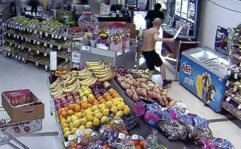 The alleged shoplifter was chased out of the IGA store by the shirtless shopper. Source: Nine News