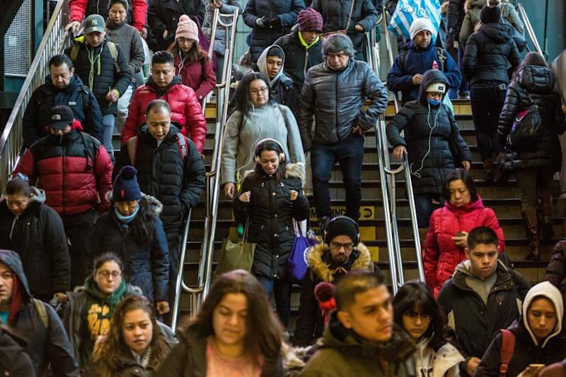 Subway passengers enter the Roosevelt Avenue station, Tuesday, December 18, 2018, in Jackson Heights, New York. It is considered one of the most diverse communities in the United States, with more than 160 languages being spoken.
