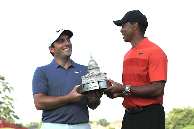 """<h1 class=""""title"""">Quicken Loans National - Final Round</h1> <div class=""""caption""""> Francesco Molinari is handed the Quicken Loans National trophy from event host Tiger Woods at TPC Potomac on July 1, 2018. </div> <cite class=""""credit"""">Sam Greenwood</cite>"""