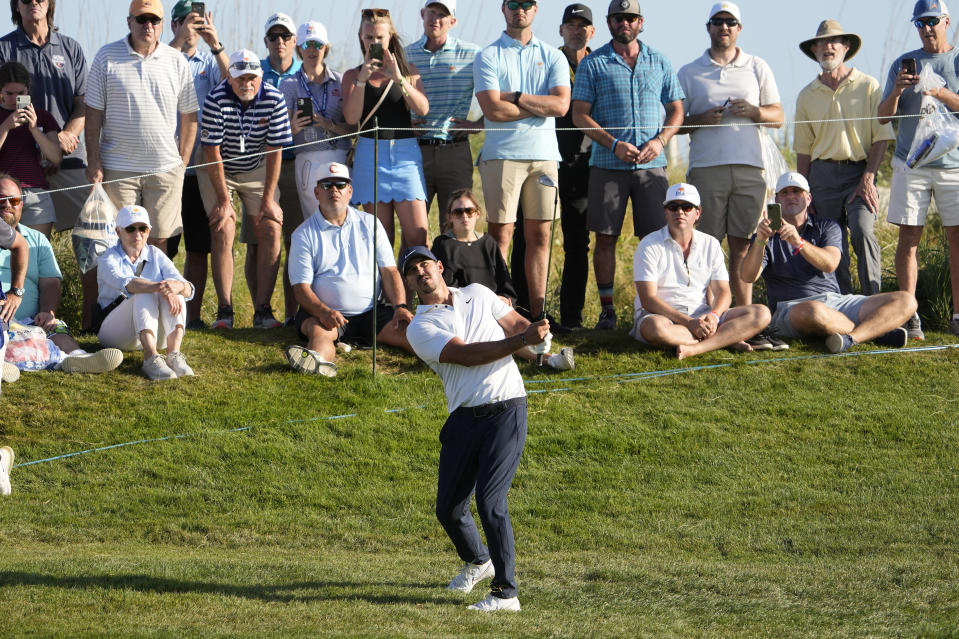 Brooks Koepka watches his shot on the 15th hole during the second round of the PGA Championship golf tournament on the Ocean Course Friday, May 21, 2021, in Kiawah Island, S.C. (AP Photo/David J. Phillip)