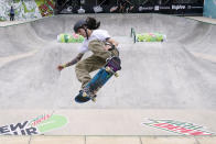 Jose Daniel Zapata Arisrizabal, of Colombia, practices during an Olympic qualifying skateboarding event at Lauridsen Skatepark, Wednesday, May 19, 2021, in Des Moines, Iowa. The questions under the magnifying glass at this week's Dew Tour — one of the last major qualifying events for the games in Tokyo in July — is whether the Olympics is ready for skateboarding and, more tellingly, whether skateboarding is ready for the Olympics. (AP Photo/Charlie Neibergall)