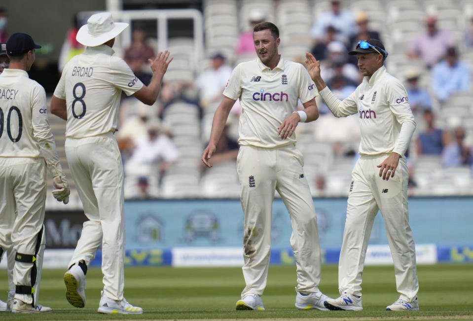 England's Ollie Robinson, centre, celebrates taking the wicket of New Zealand's Ross Taylor during the first day of the Test match between England and New Zealand at Lord's cricket ground in London, Wednesday, June 2, 2021. (AP Photo/Kirsty Wigglesworth)