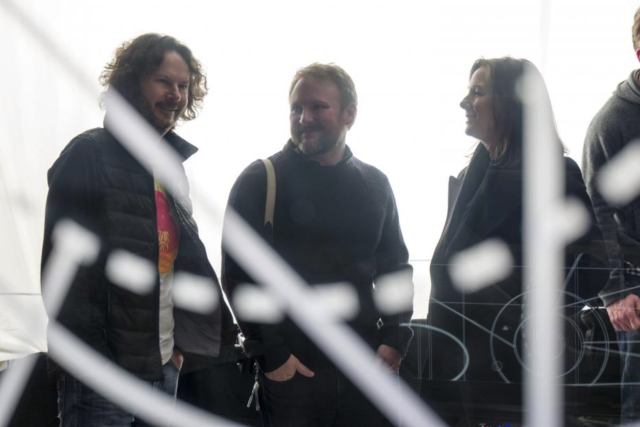 "Producer Ram Bergman, left, writer-director Rian Johnson, and Lucasfilm president Kathleen Kennedy on the set of ""Star Wars: The Last Jedi."" (Photo: Lucasfilm)"