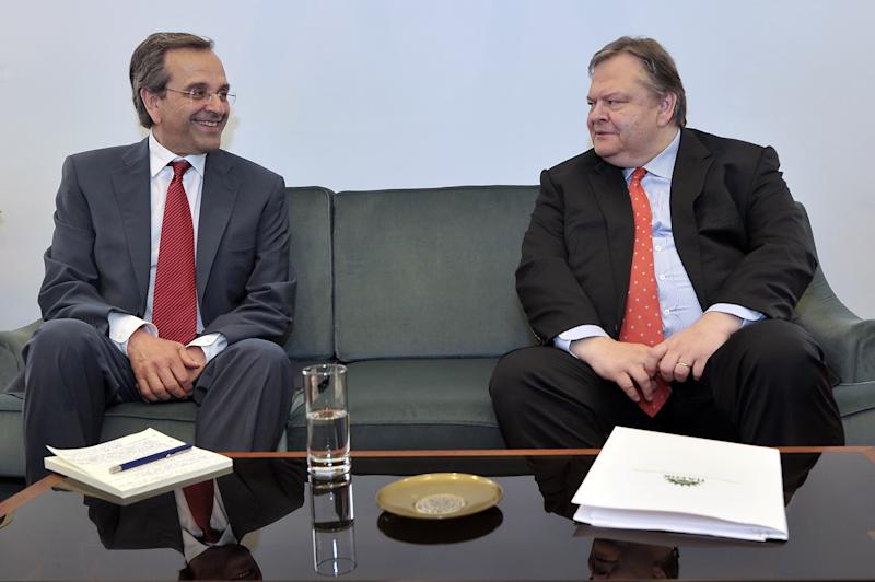 "Leader of the New Democracy conservative party Antonis Samaras, left, meets with Evangelos Venizelos, the head of the Socialist PASOK party at the Greek parliament, in Athens, on Monday, June 18, 2012. Samaras, who came first in Sunday's national election, said he will meet with leaders of all parties ""that believe in Greece's European orientation and the euro"" this afternoon in order to form a new coalition government. (AP Photo/Louisa Gouliamaki, pool)"