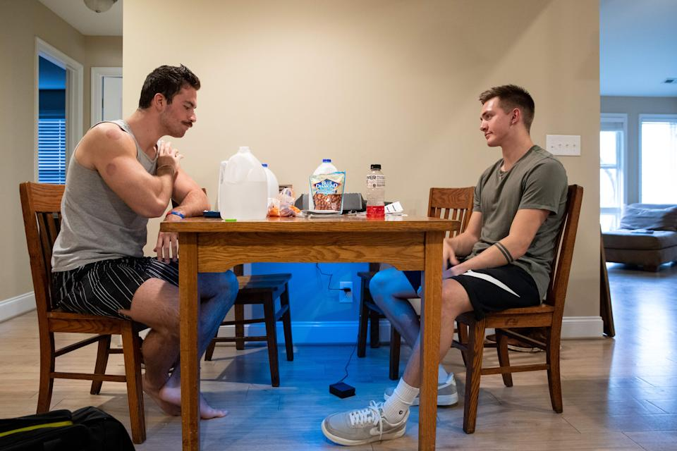 Liberty University student Jared Marshall, right, and his roommate and fellow student Jake Baker, sit inside their apartment near Lynchburg, Virginia, on March 31, 2020. (Photo by AMANDA ANDRADE-RHOADES/AFP via Getty Images)
