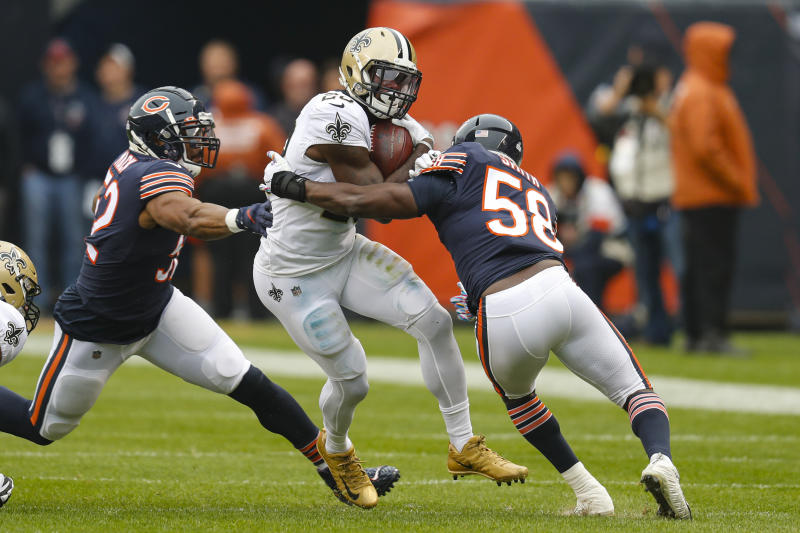 New Orleans Saints running back Latavius Murray (28) is tackled by Chicago Bears inside linebacker Roquan Smith (58) and outside linebacker Khalil Mack (52) during the first half of an NFL football game in Chicago, Sunday, Oct. 20, 2019. (AP Photo/Charles Rex Arbogast)