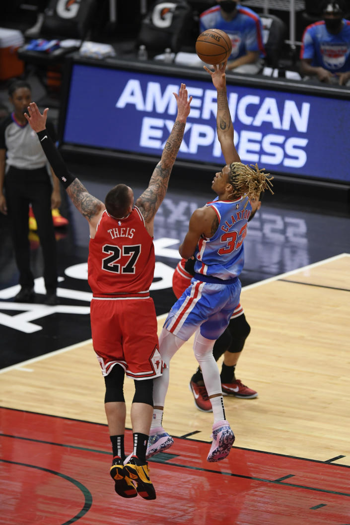 Brooklyn Nets' Nicolas Claxton, right, goes up for a shot against Chicago Bulls' Daniel Theis, left, during the first half of an NBA basketball game Sunday, April 4, 2021, in Chicago. (AP Photo/Paul Beaty)