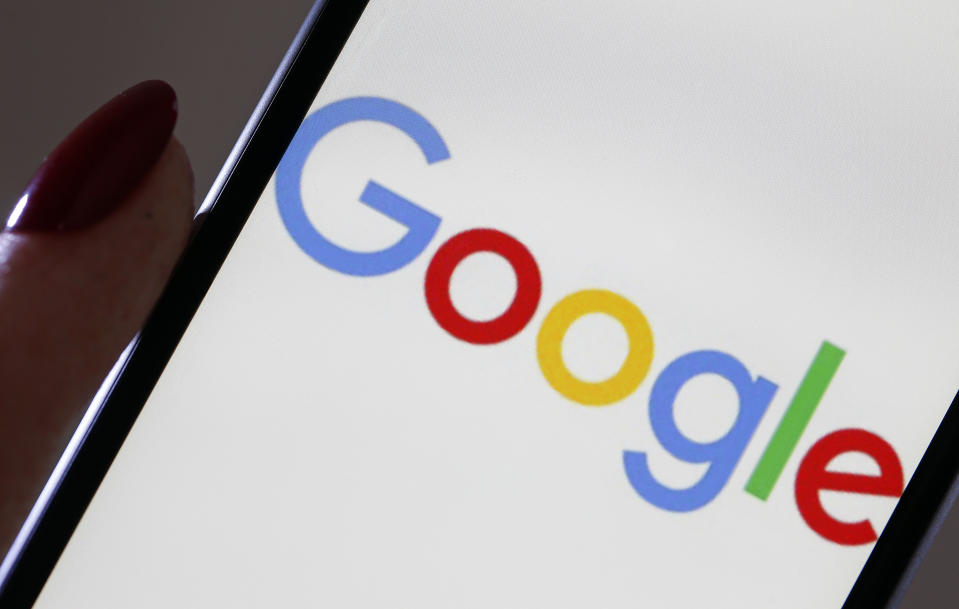 PARIS, FRANCE - MARCH 20: In this photo illustration, the Google logo is displayed on the screen of an iPhone on March 20, 2019 in Paris, France. Today, the European Commission has punished Google for a fine of 1.49 billion euros for abuse of dominant position in the search and advertising market via its AdSense offer. Google is the most used web search engine in the world. In 2018, 90% of Internet users used it in the world. (Photo by Chesnot/Getty Images)