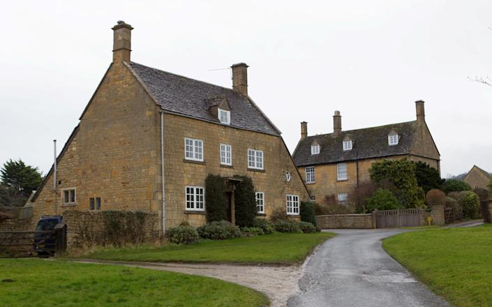 Mr and Mrs Owens now live in separate houses next door to each other in Broadway, Worcestershire, with Mrs Owens residing in the detached property on the left and her husband on the right. (SWNS)