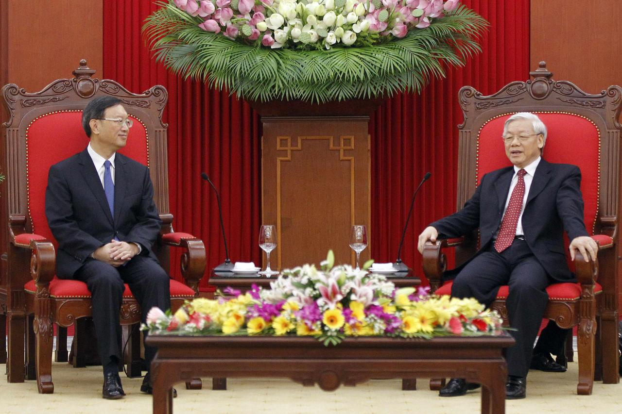 "Chinese State Councilor Yang Jiechi (L) listens to Vietnamese Communist Party's General Secretary Nguyen Phu Trong (R) during a meeting in Hanoi, June 18, 2014. China's top diplomat scolded Vietnamese officials during talks in Hanoi on Wednesday for ""hyping up"" a row over a Chinese oil rig drilling in disputed waters in the South China Sea, in tough comments that suggest relations will remain rocky. State Councilor Yang Jiechi also told his hosts that the rig's activities in waters also claimed by Vietnam were ""completely legal"", China's Foreign Ministry spokeswoman Hua Chunying said at a daily briefing in Beijing. REUTERS/Luong Thai Linh/Pool (VIETNAM - Tags: POLITICS)"