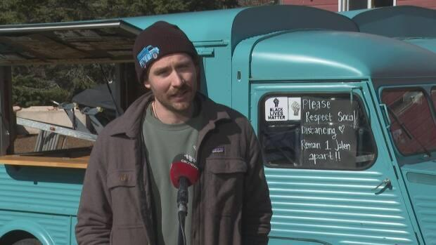Jalen MacLeod, owner of Truckin' Roll ice cream, says he felt anger and disappointment when he learned Victoria had rejected his permit to bring his truck back to the town this summer.  (Wayne Thibodeau/CBC - image credit)