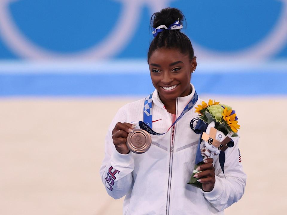 Simone Biles of Team United States poses with the bronze medal (Getty)