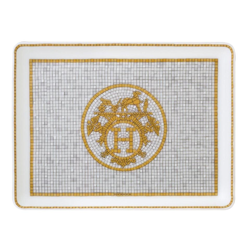 """<p><strong>Hermes</strong></p><p>jungleeny.com</p><p><strong>$190.00</strong></p><p><a href=""""https://jungleeny.com/collections/best-sellers/products/mosaique-au-24-rectangular-tray-sushi-plate"""" rel=""""nofollow noopener"""" target=""""_blank"""" data-ylk=""""slk:SHOP NOW"""" class=""""link rapid-noclick-resp"""">SHOP NOW</a></p><p>When in doubt, a serving piece that doubles as a centerpiece vessel or trinket dish is foolproof—especially when it makes a statement without anything on it, like this option from Hermes. </p>"""
