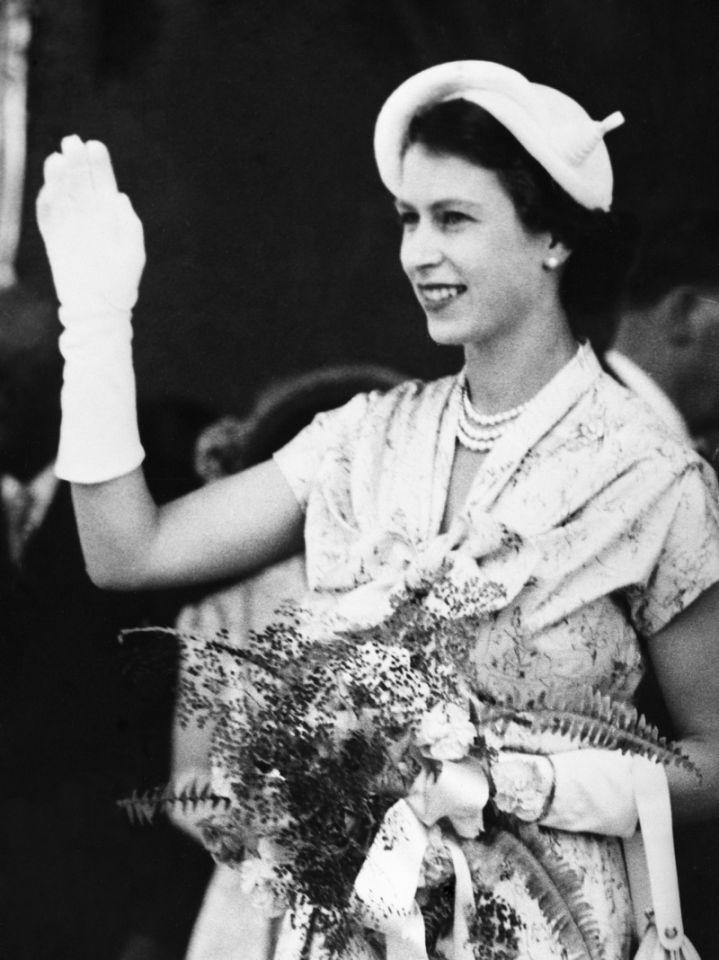 <p>Queen Elizabeth II waves at the crowds in New Zealand on her first royal tour. (PA) </p>