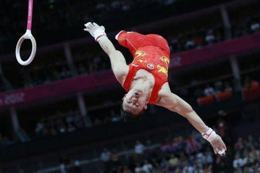 China's gymnast Chen Yibing performs to win silver in the men's rings final