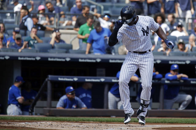 New York Yankees' Andrew McCutchen celebrates his solo home run as he crosses home plate during the first inning of a baseball game against the Toronto Blue Jays on Sunday, Sept. 16, 2018, in New York. (AP Photo/Adam Hunger)