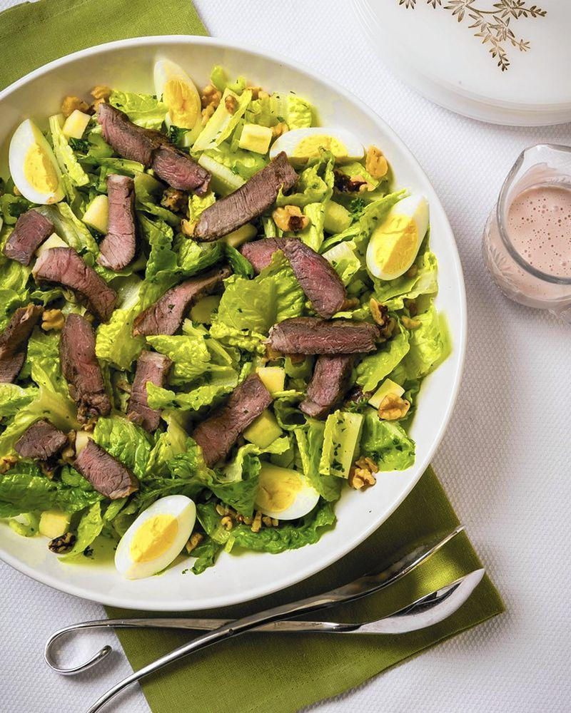 """<p>If you are keeping your Passover celebration small and simple this year or if you are looking for something to make on those non-seder days, this seder plate salad is a great choice. For this recipe, kosher cooking queen Paula Shoyer takes inspiration from a French nicoise salad but uses lamb instead of tuna and incorporates other seder plate elements. Skip the meat to <a href=""""https://www.thedailymeal.com/cook/50-vegetarian-recipes-meatless-mondays-or-any-other-time-slideshow?referrer=yahoo&category=beauty_food&include_utm=1&utm_medium=referral&utm_source=yahoo&utm_campaign=feed"""" rel=""""nofollow noopener"""" target=""""_blank"""" data-ylk=""""slk:make it vegetarian"""" class=""""link rapid-noclick-resp"""">make it vegetarian</a>.</p> <p><a href=""""https://www.thedailymeal.com/recipes/seder-plate-salad-recipe?referrer=yahoo&category=beauty_food&include_utm=1&utm_medium=referral&utm_source=yahoo&utm_campaign=feed"""" rel=""""nofollow noopener"""" target=""""_blank"""" data-ylk=""""slk:For the Seder Plate Salad recipe, click here."""" class=""""link rapid-noclick-resp"""">For the Seder Plate Salad recipe, click here.</a></p>"""